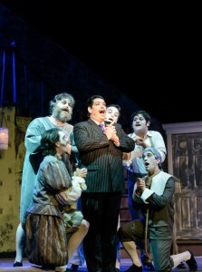 "Vince Musgrave (center) as Gomez Addams and the Male Ancestors singing ""Morticia"""