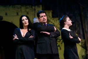 Alicia Sweeney (left) as Morticia, Vince Musgrave (center) as Gomez, and Lucy Bobbin (right) as Wednesday in The Addams Family