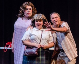 Roger Schulman (left) as Edna Turnblad, Amy E. Haynes (center) as Tracy Turnblad, and Greg Guyton (right) as Wilbur Turnblad