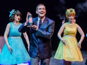 "Jeremy Goldman (center) as Corny Collins singing the show's title song ""It's Hairspray!"""