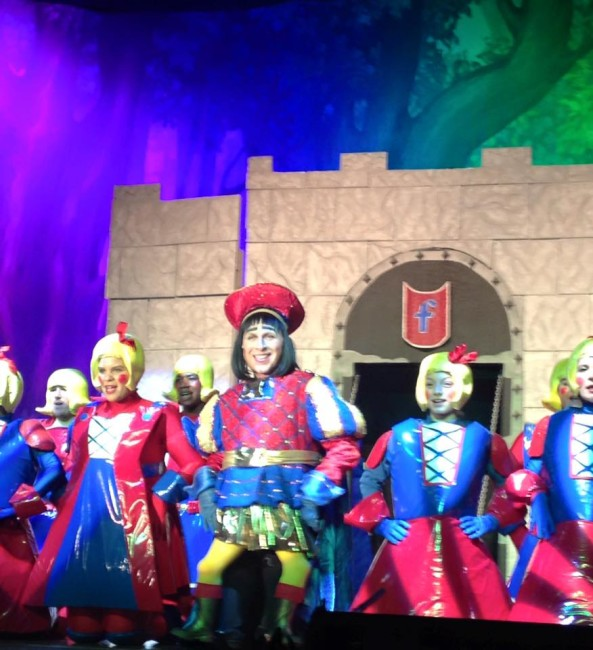 Homero Bayarena as Lord Farquaad (center) and the Duloc Dancers in Shrek the Musical