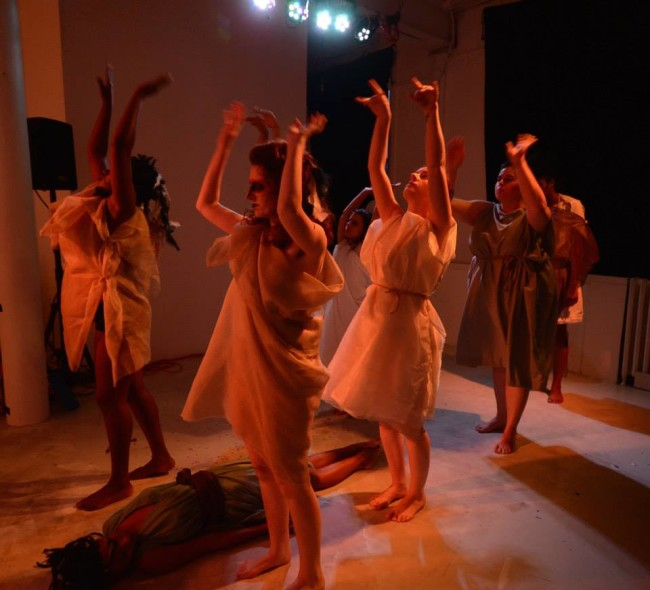 Iphigenia (Paris Brown, floor) and Agamemnon (Dana Woodson, back) while The Chorus (l-r, front to back Trustina Fafa Sabah, Sarah Weissman, Ren Pepitone, Katharine Vary, and Andrea Bush) recalls Agamemnon's fateful trip to the woods