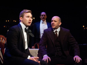 Josh Adams (left) as Eric Birling, Bruce Randolph Nelson (center) as Arthur Birling, and Chris Genebach (right) as Inspector Goole in An Inspector Calls at Everyman Theatre