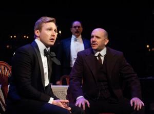 Josh Adams (left) as Eric Birling, Bruce Randolph Nelson (center) as Arthur Birling, and Chris Genebach (right) as Inspector Goole in An Inspector Calls at Everyman Theatre