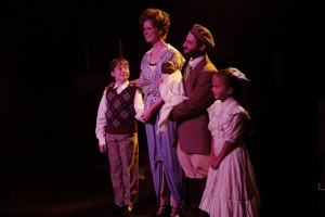 (L to R) Edgar (Gavin Willard) Mother (Elizabeth Rayca) Tateh (Josh Simon) and Little Girl (Ella Boodin) in Ragtime at Toby's Dinner Theatre