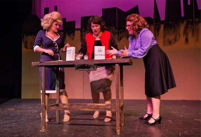 Violet (Robyn Bloom, c) tells Doralee (Lucy Bobbin, r) and Judy (Caitlin Grant, r) that she has poisoned Mr. Hart