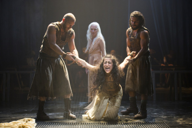 Foreground, from left: Elan Zafir as Abaddon, Nadine Malouf as Salomé, and Shahar Isaac as Bar Giora, with Olwen Fouéré, background, as Nameless Woman in Yaël Farber's Salomé at the Shakespeare Theatre Company