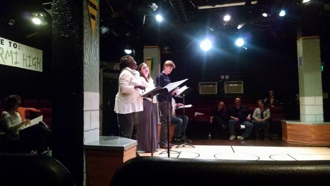 Debbie Bennett (left) reading as Philomena, Ryan Gunning (center) reading as Beth, David Shoemaker (right) reading as Matt, and Mark Scharf (seated and half-hidden) playwright of The Quickening