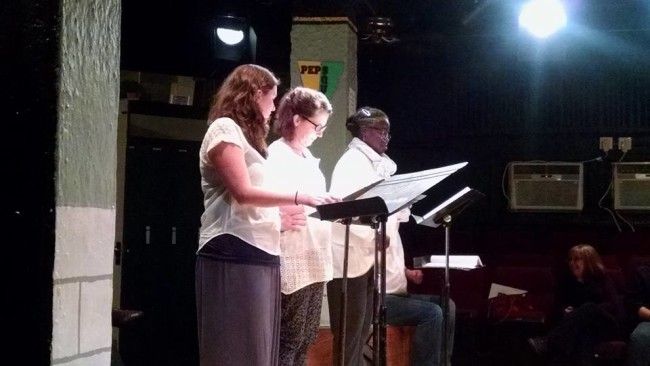 Ryan Gunning (left) reading as Beth, Marianne Angelella (center) reading as Rosemary, Debbie Bennett (right) reading as Philomena, and Mark Scharf (seated and half-hidden) playwright, The Quickening