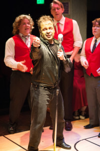 """Zombie Jonny (Alex Cecchetti, center) and the Motorwise Guys singing """"How Can I Say Good-Bye?"""" in Zombie Prom"""