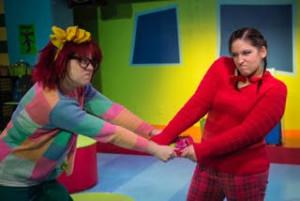 Emily Raines (left) as Junie B. Jones and Tori Weaver (right) as May in Junie B. Jones Jingle Bells Batman Smells at MET's Fun Company