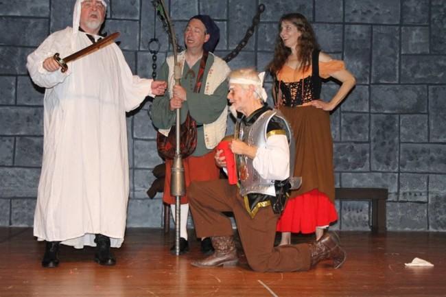 (L to R) Rodney Bonds as The Innkeeper, Paul Ballard as Sancho Panza, Michael Hulett as Don Quixote, and Ruth Hulett as Aldonza