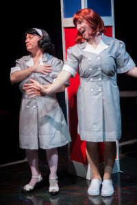Matt Wetzel (left) as Helen Bedd and Adam Abruzzo (right) as Inita Goodwin in A Tuna Christmas at Spotlighters Theatre