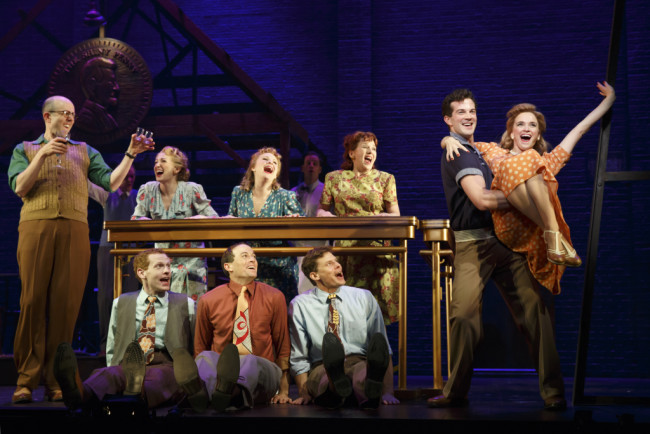 "Jeff Blumenkrantz (left); A.J. Shively, Emily Padgett (right); and the cast of ""Bright Star"" at the Kennedy Center."