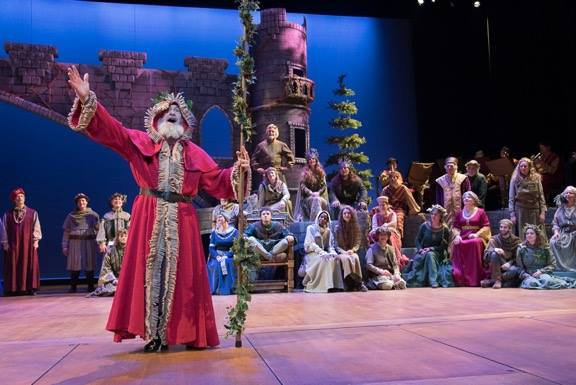 Will Wurzel (off-center left) as Father Christmas with the company of The Christmas Revels 2015