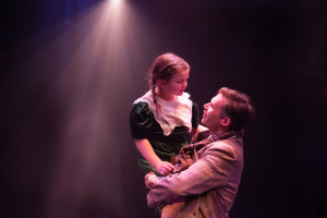 Lilianna Robinson (left) as Zuzu and Matthew Schleigh (right) as George Bailey in It's a Wonderful Life: The Musical