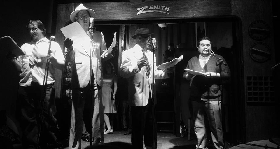 (L to R) Chris Allen as the Rookie Gumshoe, Jeffrey Gangwisch as Theodore16, Craig Coletta as Bennington Marcus, and John Bennett as The Chief reading Haunted Chrome: A Bennington Marcus Mystery