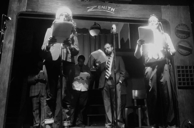Emily Moore (left) as Irene Payton, Marty Day (center) as the unidentified creature, and Michael Stevenson (right) as press man Rob Becker reading The Incident at Red Belles Farms by Alfred Underhill