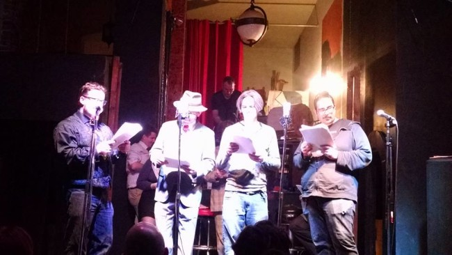 "(L to R) Todd Gardiner, Doug Johnson, Mike Jancz, and Aaron Travis reading ""Chap Sweat: Home Harvest"" written by Chaz Kedesla"