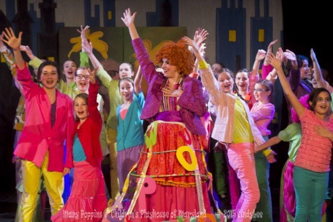 "Rachel Miller (center) as Mrs. Corry and the ensemble of Mary Poppins performing ""Supercalifragilisticexpialidocious"""
