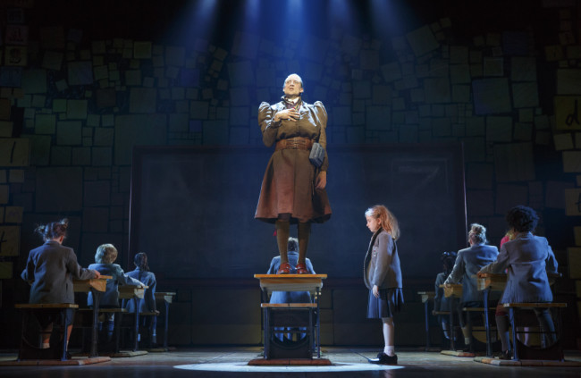 Bryce Ryness (Miss Trunchbull) and Mabel Tyler (Matilda Wormwood) and The Company of Matilda The Musical National Tour