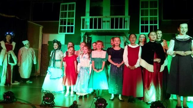 The Chorus of A Christmas Carol at Twin Beach Players