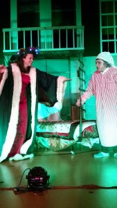Katie Evans (left) as Ghost of Christmas Present and Annie Gorenflo (right) as Scrooge