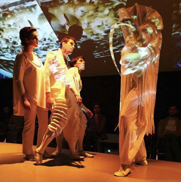 Caroline Preziosi (left) as Chromatistes, Eric Park (center) as Q, and Ren Pepitone (right) as Q2 with Dave Iden (far right) as Fenir in Flatland
