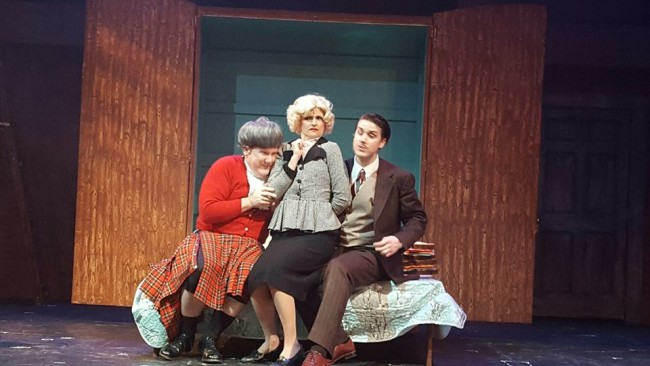 Thomas C. Hessenauer (left) as Mrs. McGarrigle, Tatiana Dalton (center) as Pamela, and Charles Lidard (right) as Richard Hannay in The 39 Steps