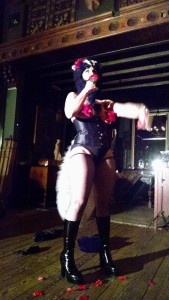 "Reverend Valentine performing her routine to ""Love Stinks"""