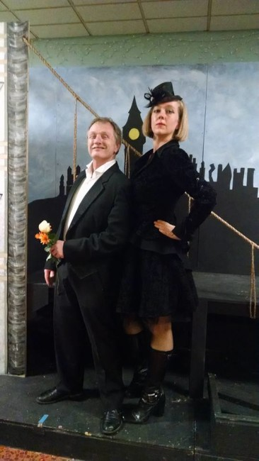 Director Ed Higgins (left) as Mr. Brownlow stands with TheatreBloom reviewer Amanda Gunther (right) before the London Bridge set (designed by Set Designer Jordan Hollet) at Third Wall Productions' Oliver!