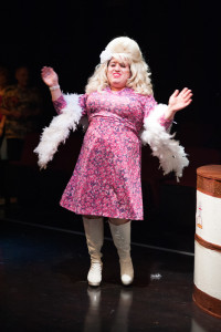 Tommy Malek as Iona Traylor, Benny Watson's drag persona in Southern Baptist Sissies