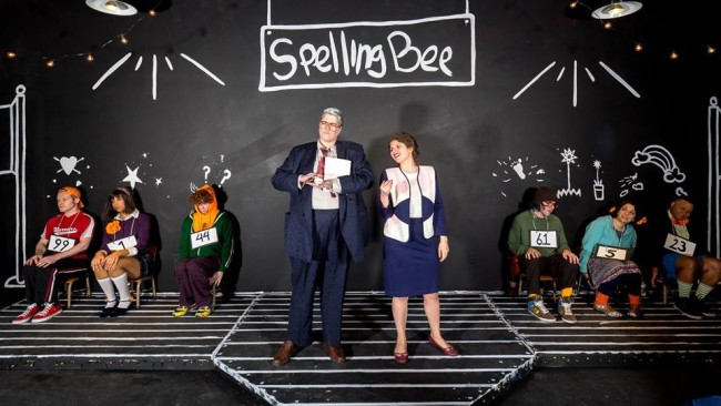 Danielle Robinette (center left) as Doug Panch and Zoe Kanter (center right) as Rona Lisa Peretti in The 25th Annual Putnam County Spelling Bee