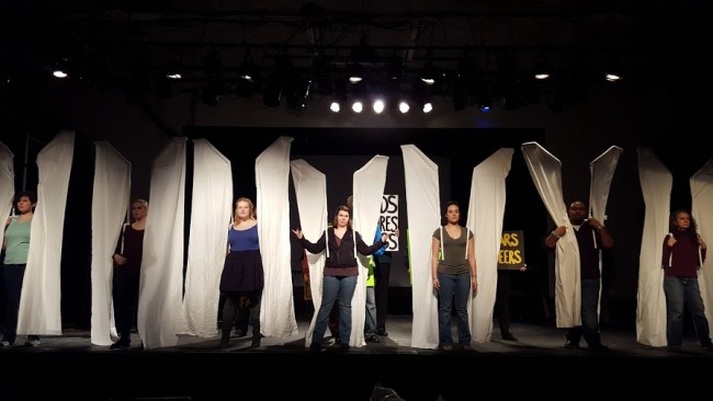 Clancey Yovanovich (center) as Romaine Patterson, leading the Action Angels in The Laramie Project at Kensington Arts Theatre