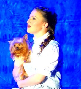 Lucy Bobbin as Dorothy with Summer Johnson as Toto in The Wizard of Oz at Suburban Players