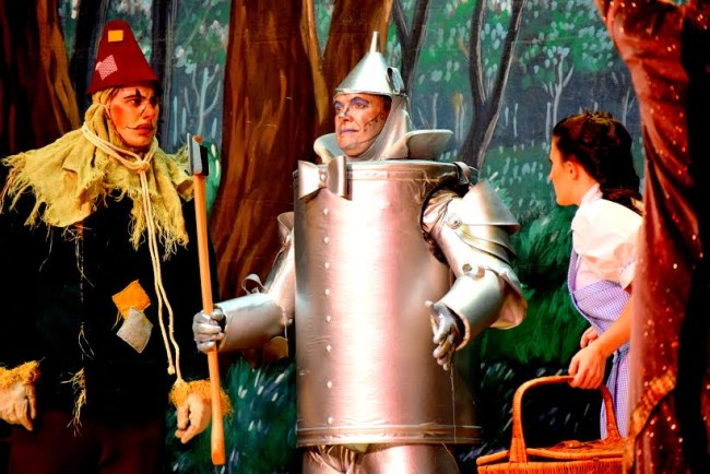 Jamie Austin Jacobs (left) as Scarecrow, Michael Quinn (center) as Tinman, and Lucy Bobbin (right) as Dorothy in The Wizard of Oz at Suburban Players