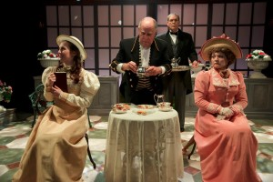 (L to R) Teresa Spencer as Cecily, Larry Levinson as Merriman the Butler, Timothy Sayles as Lane the manservant, and Renata Plecha as Gwendolen in The Importance of Being Earnest