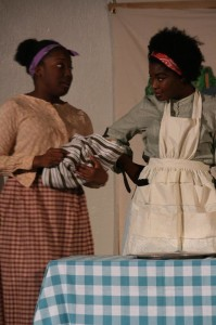 Zipporah Brown (left) as Vivian and Trustina Fafa Sabah (right) as Shilo in Harry and the Thief at Strand Theater Company