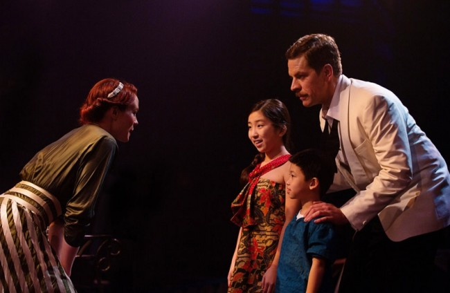 Teresa Danskey (left) as Nellie Forbush and Russell Rinker (right) as Emile de Becque in South Pacific at Toby's Dinner Theatre