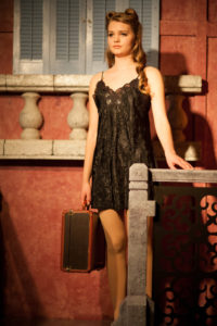 "Claire Iverson as The Mistress performing ""Another Suitcase in Another Hallway"" in Evita at Spotlighters Theatre"