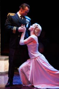Bart Debicki (left) as Juan Perón and Becca Vourvoulas (right) as Eva Perón in Evita at Spotlighters Theatre