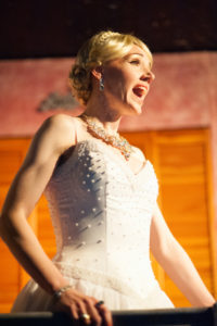 Becca Vourvoulas as Eva Duarte Perón in Evita at Spotlighters Theatre