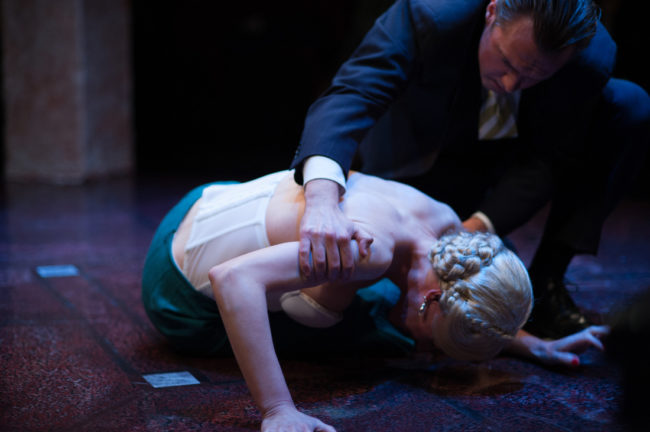 Becca Vourvoulas (left) as Eva Perón and Bart Debicki (right) as Juan Perón in Evita at Spotlighters Theatre