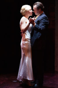 Becca Vourvoulas (left) as Eva and Bart Debicki (right) as Perón in Evita at Spotlighters Theatre