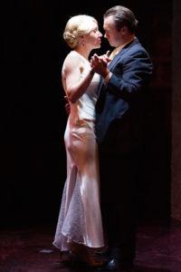 Becca Vourvoulas (left) as Eva and Bart Debicki (right) as Perón in Evita at Spotlighters Theatre
