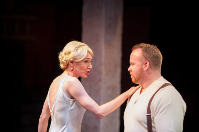 Becca Vourvoulas (left) as Eva Perón and Rob Wall (right) as Ché in Evita at Spotlighters Theatre