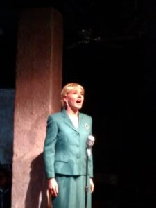 A tech-week rehearsal shot of Becca Vourvoulas as Eva Perón in Evita at Spotlighters Theatre