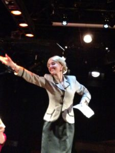 A tech-week rehearsal photo of Becca Vourvoulas as Eva in Evita at Spotlighters Theatre