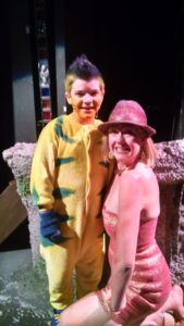 Judah Latshaw (left) as Flounder and TheatreBloom Reviewer Amanda N. Gunther (right) at Milburn Stone Theatre's The Little Mermaid