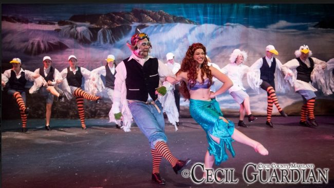 "Dane Hutchinson (left) as Scuttle and Karalyn Joseph (right) as Ariel and the gulls tapping to ""Positoovity"" in The Little Mermaid"